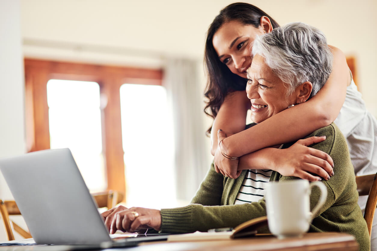 caregiver helping with online services