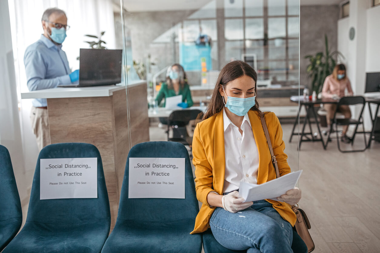woman in waiting room wearing mask
